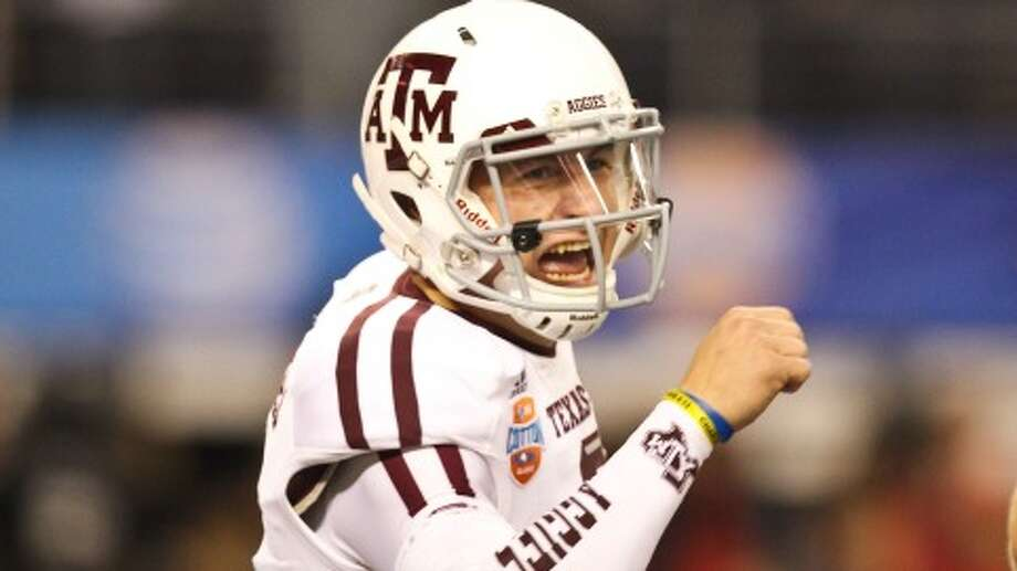 Texas A&M quarterback Johnny Manziel is winning on and off the field. (Nick de la Torre/Chronicle)