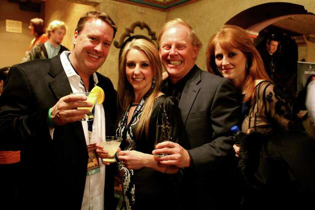 Attendees kick off the 2nd Annual San Antonio Cocktail Conference Jan. 17, 2013, at the Majestic Theater, where ambassadors of select spirit brands host bars throughout the three levels of the historic theater, crafting and serving a variety of specialty cocktails. Photo: Yvonne Zamora/For The Express-News