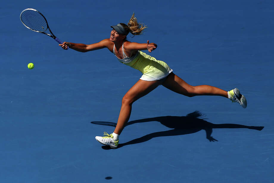 Maria Sharapova of Russia plays a forehand in her first round match against Olga Puchkova of Russia during day one of the 2013 Australian Open at Melbourne Park on January 14, 2013 in Melbourne, Australia. Photo: Ryan Pierse, Getty Images / 2013 Getty Images