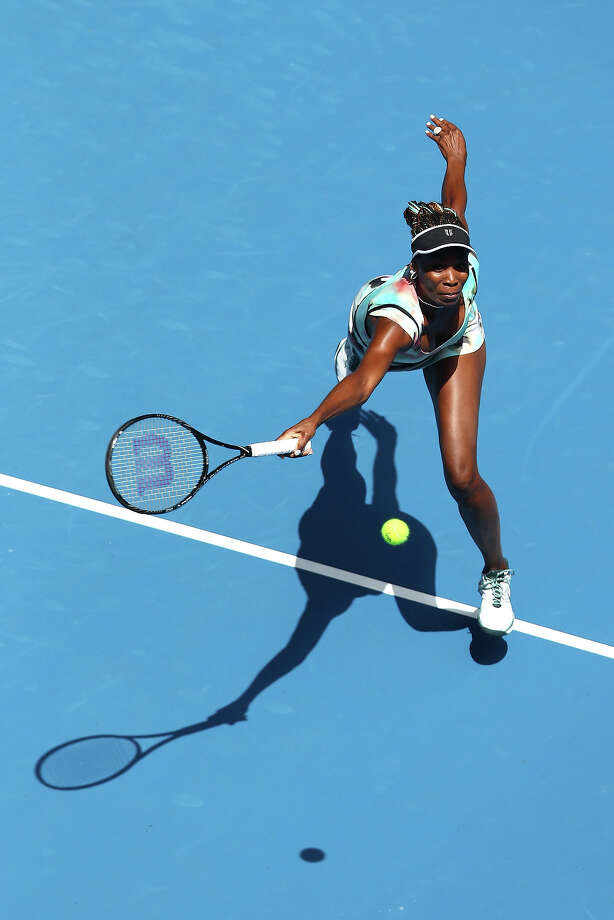 Venus Williams of the United States plays a forehand in her first round match against Galina Voskoboeva of Kazakhstan during day one of the 2013 Australian Open at Melbourne Park on January 14, 2013 in Melbourne, Australia. Photo: Mark Kolbe, Getty Images / 2013 Getty Images
