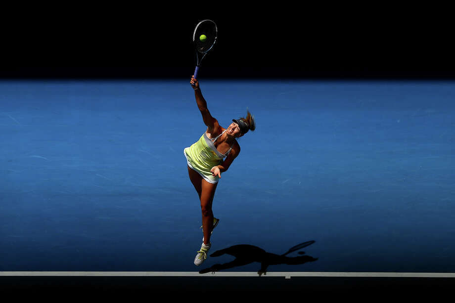 Maria Sharapova of Russia serves in her first round match against Olga Puchkova of Russia during day one of the 2013 Australian Open at Melbourne Park on January 14, 2013 in Melbourne, Australia. Photo: Ryan Pierse, Getty Images / 2013 Getty Images