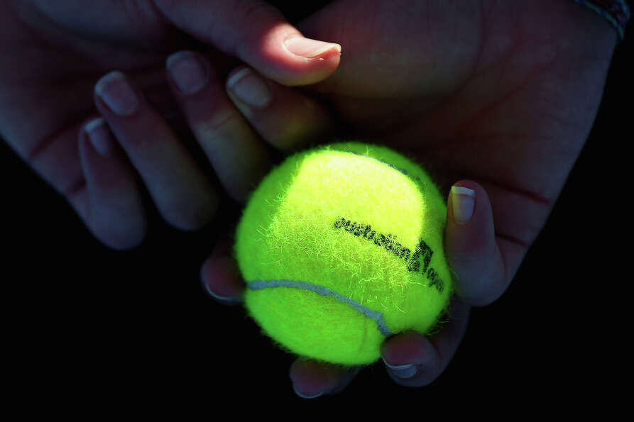 An Australian Open tennis ball is seen during day one of the 2013 Australian Open at Melbourne Park