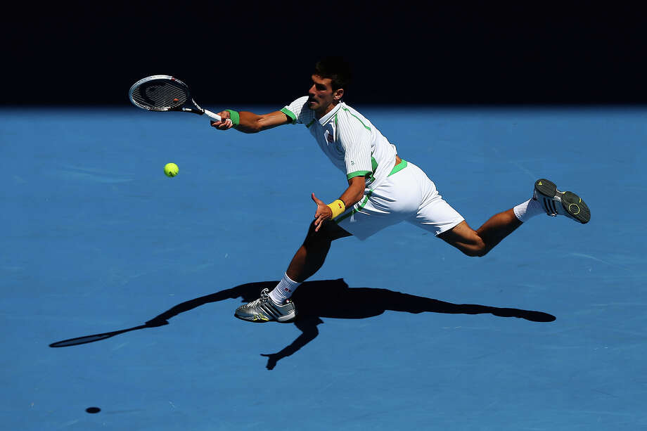 Novak Djokovic of Serbia plays a forehand in his first round match against Paul-Henri Mathieu of France during day one of the 2013 Australian Open at Melbourne Park on January 14, 2013 in Melbourne, Australia. Photo: Ryan Pierse, Getty Images / 2013 Getty Images