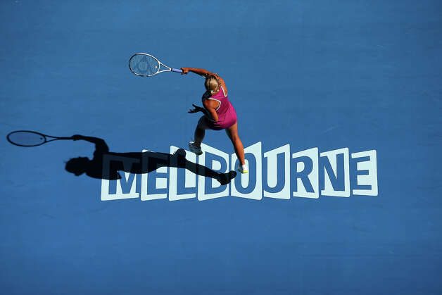 Dominika Cibulkova of Slovakia plays a forehand in her first round match against Ashleigh Barty of Australia during day one of the 2013 Australian Open at Melbourne Park on January 14, 2013 in Melbourne, Australia. Photo: Julian Finney, Getty Images / 2013 Getty Images
