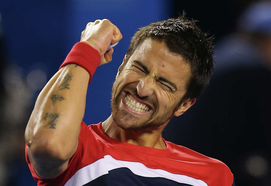 Janko Tipsarevic of Serbia celebrates winning his first round match against Lleyton Hewitt of Australia during day one of the 2013 Australian Open at Melbourne Park on January 14, 2013 in Melbourne, Australia. Photo: Scott Barbour, Getty Images / 2013 Getty Images