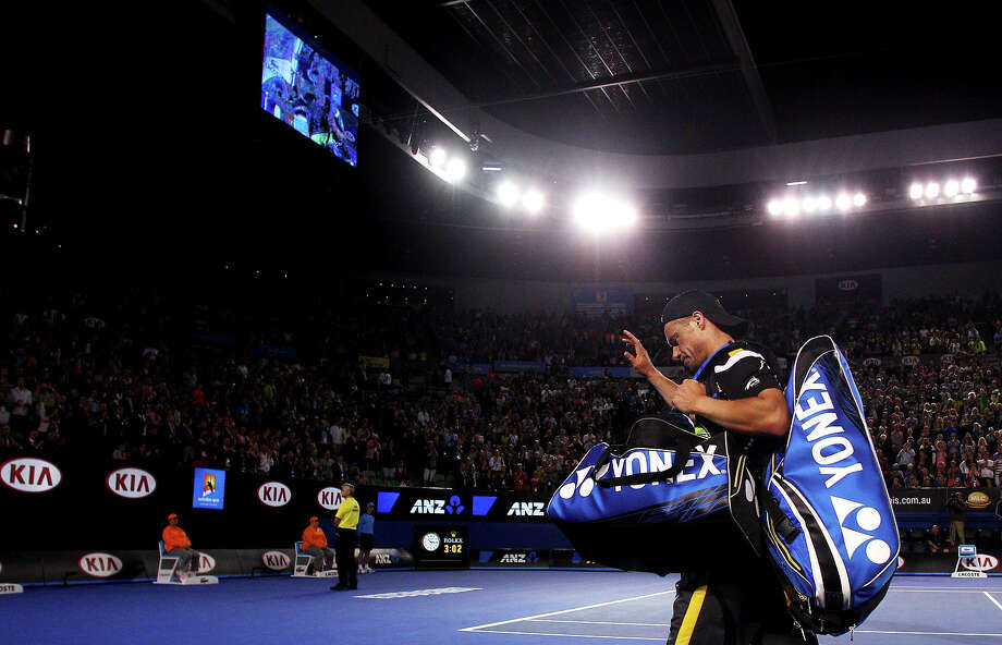 Lleyton Hewitt of Australia leaves the court after losing his first round match against Janko Tipsarevic of Serbia during day one of the 2013 Australian Open at Melbourne Park on January 14, 2013 in Melbourne, Australia. Photo: Marianna Massey, Getty Images / 2013 Getty Images