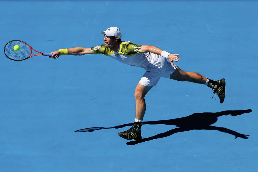 Andy Murray of Great Britain plays a forehand in his first round match against Robin Haase of the Ne