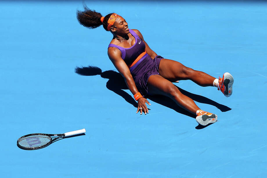 Serena Williams of the United States falls onto the court injuring her ankle in her first round match against Edina Gallovits-Hall of Romania during day two of the 2013 Australian Open at Melbourne Park on January 15, 2013 in Melbourne, Australia. Photo: Robert Prezioso, Getty Images / 2013 Getty Images