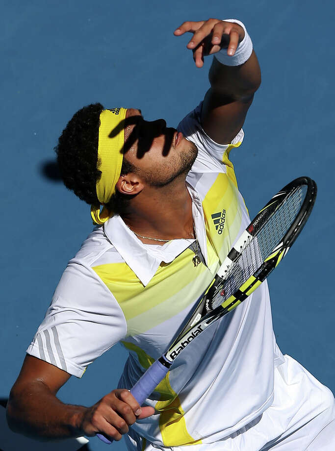 Jo-Wilfried Tsonga of France serves in his first round match against Michael Llodra of France during day two of the 2013 Australian Open at Melbourne Park on January 15, 2013 in Melbourne, Australia. Photo: Michael Dodge, Getty Images / 2013 Getty Images