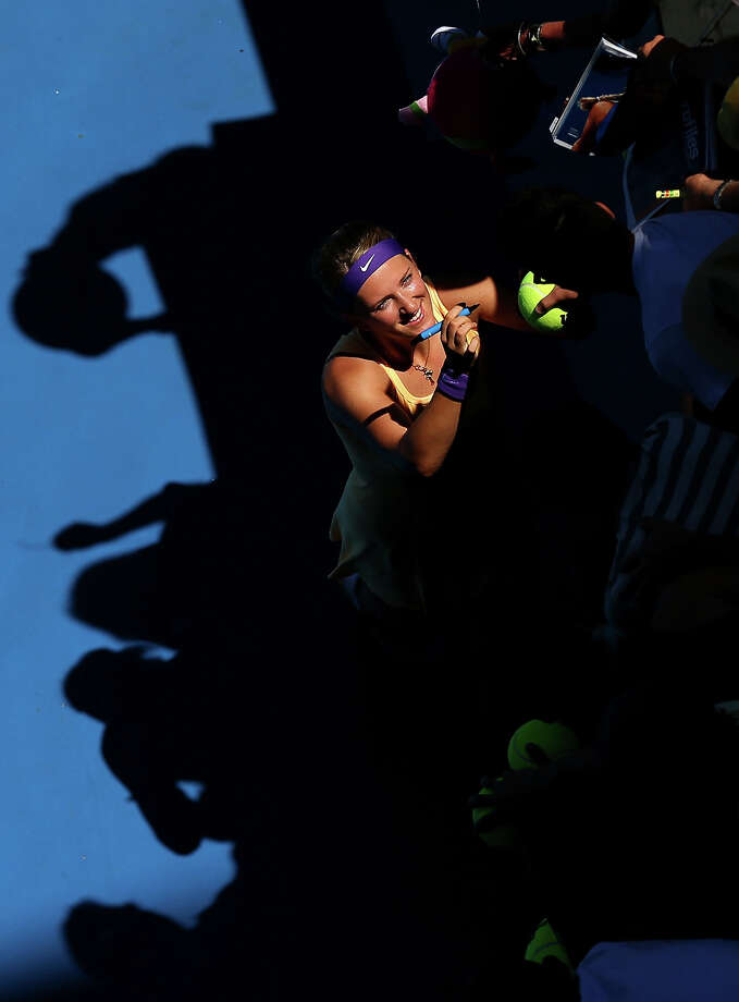 Victoria Azarenka of Belarus signs autographs for fans after winning her first round match against Monica Niculescu of Romania during day two of the 2013 Australian Open at Melbourne Park on January 15, 2013 in Melbourne, Australia. Photo: Cameron Spencer, Getty Images / 2013 Getty Images