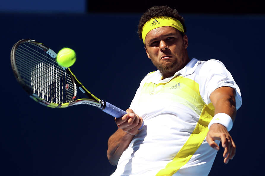 Jo-Wilfried Tsonga of France plays a forehand in his first round match against Michael Llodra of Fra
