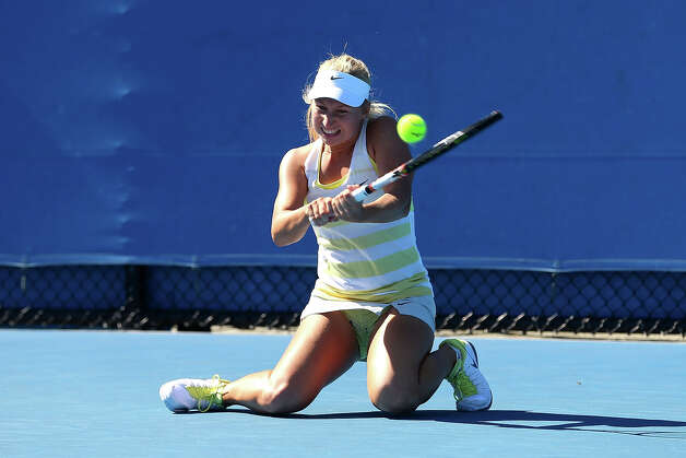 Daria Gavrilova of Russia plays a backhand in her first round match against Lauren Davis of the United States during day two of the 2013 Australian Open at Melbourne Park on January 15, 2013 in Melbourne, Australia. Photo: Julian Finney, Getty Images / 2013 Getty Images