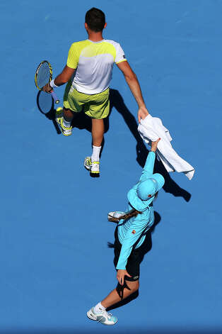 Nicolas Almagro of Spain hands a towel to a ball boy in his second round match against Daniel Gimeno-Traver of Spain during day three of the 2013 Australian Open at Melbourne Park on January 16, 2013 in Melbourne, Australia. Photo: Cameron Spencer, Getty Images / 2013 Getty Images