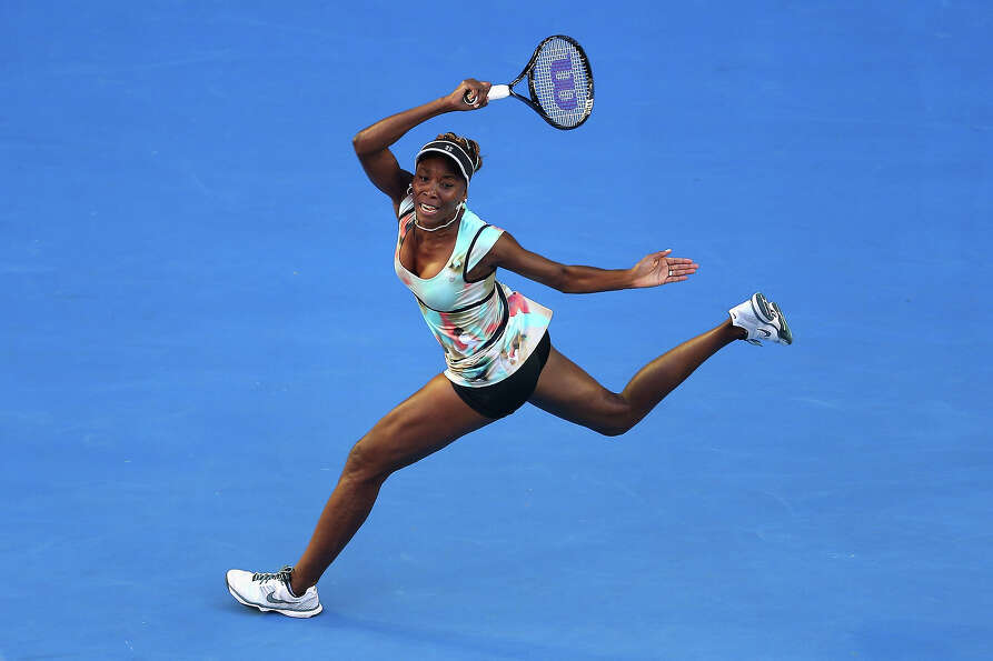 Venus Williams of the United States plays a forehand in her second round match against Alize Cornet