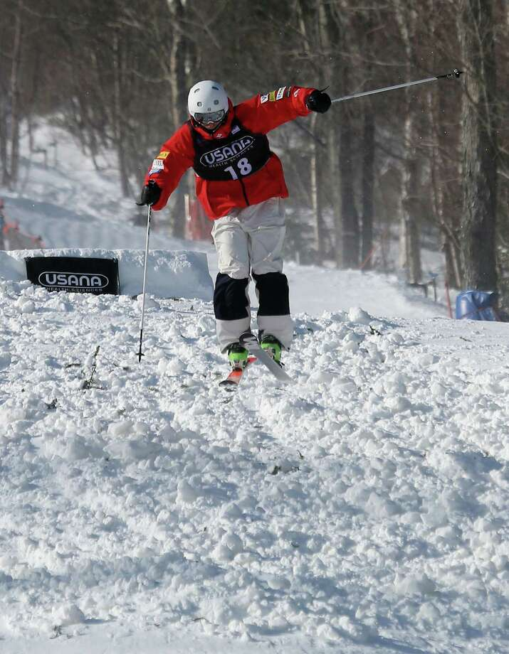 LAKE PLACID, NY - JANUARY 17:  David DiGravio #18 of the USA competes in the USANA Freestyle World Cup Moguls competition at Whiteface Mountain on January 17, 2013 in Lake Placid, New York. Photo: Bruce Bennett, Getty Images / 2013 Getty Images