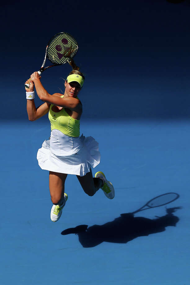 Maria Kirilenko of Russia plays a backhand in her second round match against Shuai Peng of China during day four of the 2013 Australian Open at Melbourne Park on January 17, 2013 in Melbourne, Australia. Photo: Ryan Pierse, Getty Images / 2013 Getty Images