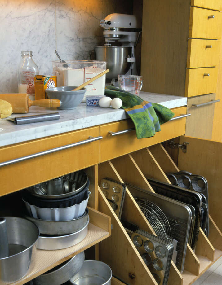Storage gives easy access to appliances, pans and ingredients. Photo: HO / BETTER HOMES AND GARDENS