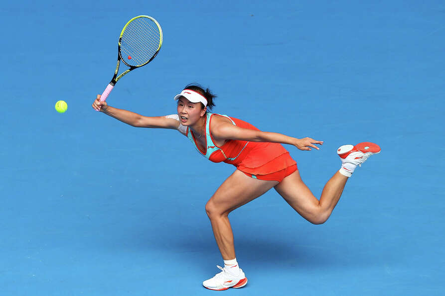 Shuai Peng of China plays a forehand in her second round match against Maria Kirilenko of Russia dur