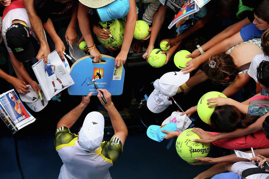 Andy Murray of Great Britain signs an autograph after winning his second round match against Joao Sousa of Portugal during day four of the 2013 Australian Open at Melbourne Park on January 17, 2013 in Melbourne, Australia. Photo: Julian Finney, Getty Images / 2013 Getty Images