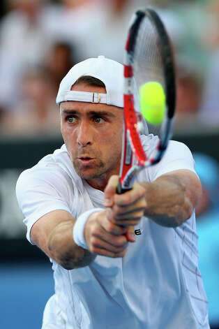 Benjamin Becker of Germany plays a backhand in his second round match against Juan Martin Del Potro of Argentina during day four of the 2013 Australian Open at Melbourne Park on January 17, 2013 in Melbourne, Australia. Photo: Cameron Spencer, Getty Images / 2013 Getty Images