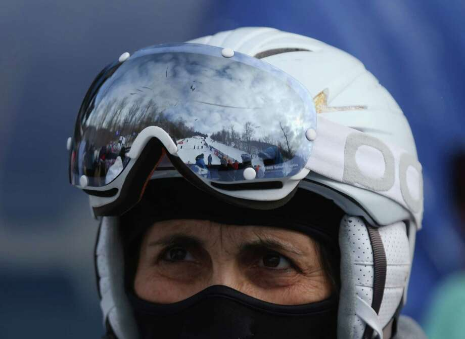 LAKE PLACID, NY - JANUARY 17:  A spectator watches the USANA Freestyle World Cup Moguls competition at Whiteface Mountain on January 17, 2013 in Lake Placid, New York. Photo: Bruce Bennett, Getty Images / 2013 Getty Images