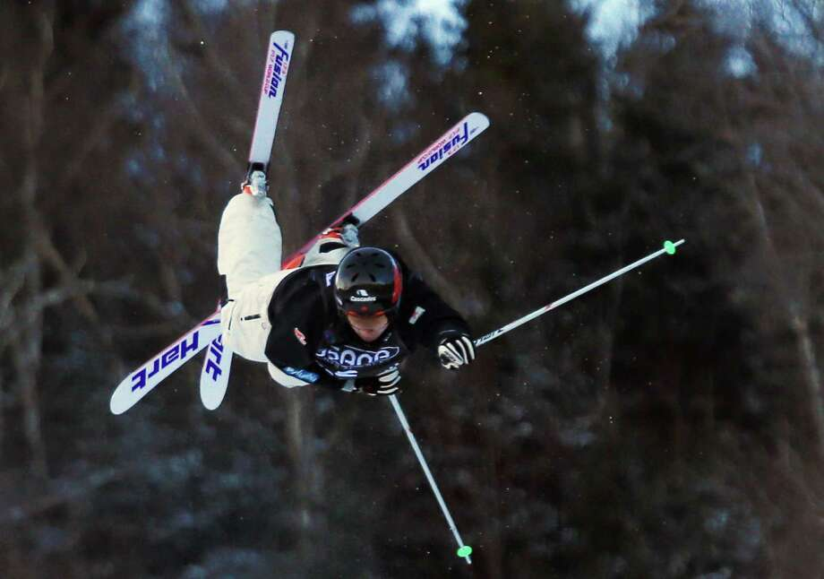 LAKE PLACID, NY - JANUARY 17:  Alex Bilodeau #2 of Canada sails over the course during the USANA Freestyle World Cup Moguls competition at Whiteface Mountain on January 17, 2013 in Lake Placid, New York. Photo: Bruce Bennett, Getty Images / 2013 Getty Images