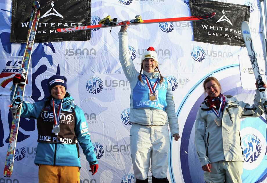 LAKE PLACID, NY - JANUARY 17:  Hannah Kearney of the USA (C) takes first place in the USANA Freestyle World Cup Ladies' Moguls competition at Whiteface Mountain on January 17, 2013 in Lake Placid, New York. Nikola Sodova #4 of the Czech Republic (L) took second place, and Brittany Cox #9 of Austria (R) took third place. Photo: Bruce Bennett, Getty Images / 2013 Getty Images