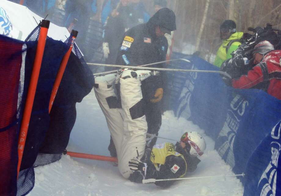 LAKE PLACID, NY - JANUARY 17:  Mikael Kingsbury of Canada bursts through the safety fence while winning the USANA Freestyle Men's World Cup Moguls competition at Whiteface Mountain on January 17, 2013 in Lake Placid, New York. Photo: Bruce Bennett, Getty Images / 2013 Getty Images