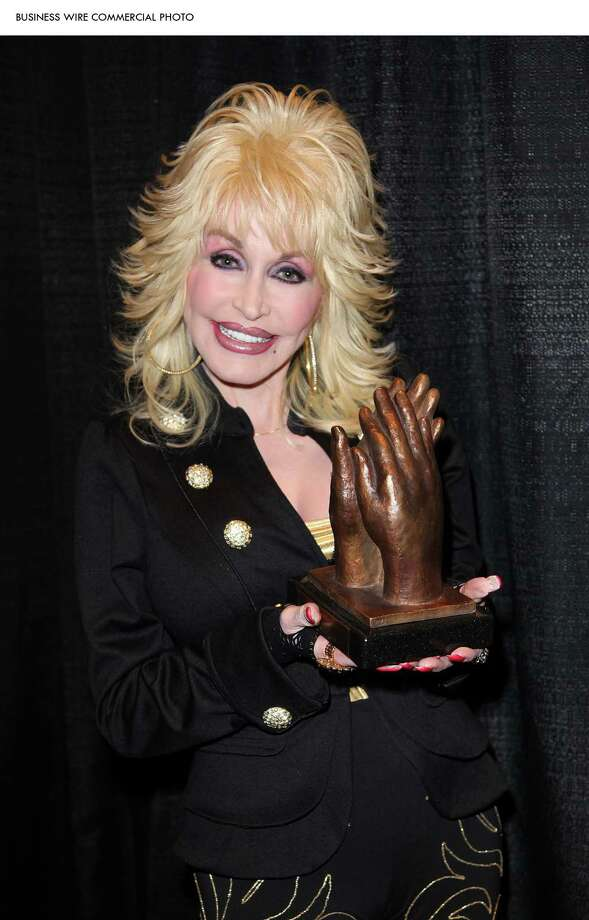 Parton is set to release her 42nd studio album in 2014. / Dollywood