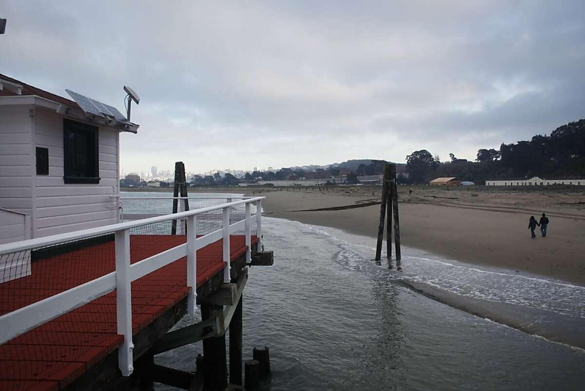 Gentle waves crash along the shoreline near Crissy Field where the oldest continuously operating tidal gauge in the Americas tracks sea level rise on the west coast on Monday Nov. 27, 2012 in San Francisco, Calif.