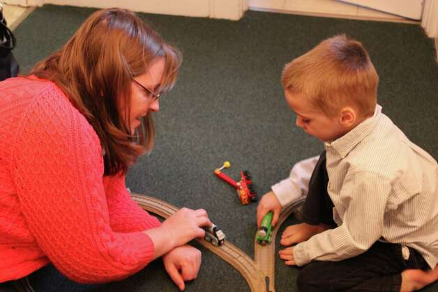 Lindsey Clark and her son, Jeremy, 4, who suffers from Dravet Syndrome play trains together. Photo: Megan Davis