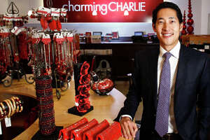 Charlie Chanaratsopon, CEO and Founder of Charming Charlie, a retail chain that sells trendy, affordable jewelry and accessories stands in his Galleria store, Wednesday, Nov. 30, 2011, in Houston.   The company has gone through a major wave of expansion, making a name for itself with many of its jewelry pieces selling for $14.95. The merchandise is grouped by color and by trend, so the stores are easy to navigate.