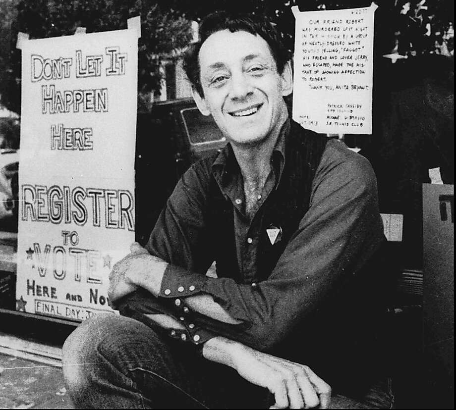 Harvey Milk poses in front of his camera shop in San Francisco in this Nov. 9, 1977, photo. Milk became one of the first openly gay men elected to public office in the United States when he won a seat on the board of supervisors in 1977. He was assassinated at City Hall, along with Mayor George Moscone, more than a year later. Photo: Associated Press