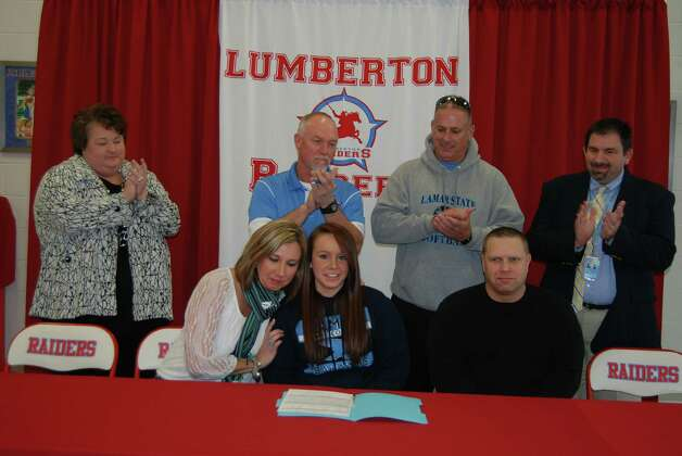 At Lumberton High School last Wednesday Taylor Harvill signed her letter of intent to play softball for Lamar University Port Arthur. Back row:  Lumberton ISD High School Principal Gretchen Scoggins, Lumberton ISD Athletic Director Alvin Credeur, Lamar Port Arthur Head Coach Vance Edwards, Lumberton ISD Assistant Superintendent Gerald Chandler  Front row: Taylor s Mom Michelle Strazz, Lumberton ISD student Taylor Harvill, Taylor s Donald Harvill Photo: Jay Cockrell