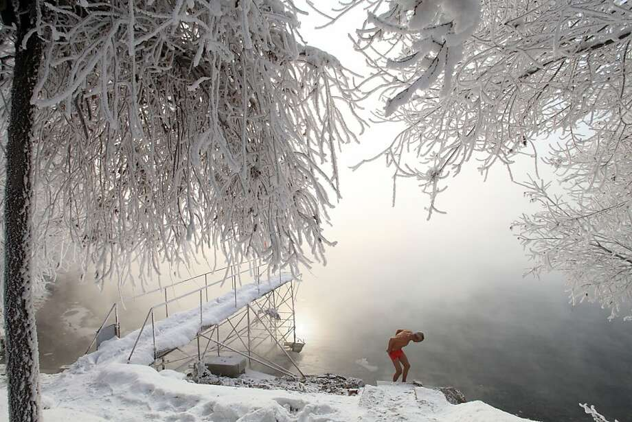 This picture taken on January 17, 2013 shows 77-year-old retired teacher Gao Yinyu preparing to go for a swin in the nude at a snow-covered bathing spot in Jilin, in northeastern China's Jilin province, in a temperature of minus 25 degrees Celsius. Gao has been exercising in only his underwear every morning for more than the past decade and has rarely caught cold ever since retirement. Photo: Str, AFP/Getty Images