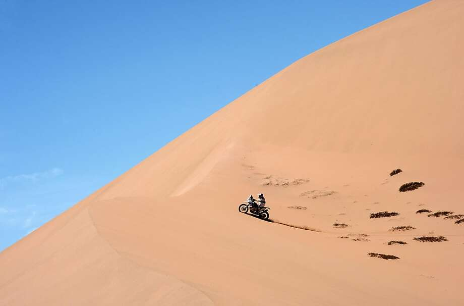 Stretch run in the sand:Those Dakar 2013 riders are still at it, cruising over the dunes between Fiambala, Argentina, and Copiapo, Chile. The great endurance race ends Sunday. Photo: Franck Fife, AFP/Getty Images