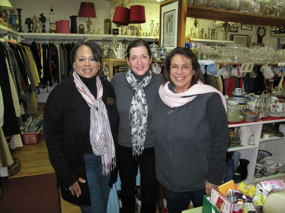 Thrift Shop volunteers Jennifer Venneri (left) and MaryAnn Gabriel (right) pose with manager Susanne Palmer (center) in the New Canaan Thrift Shop on Locust Avenue. 1/18/13. New Canaan, Conn. Photo: Tyler Woods