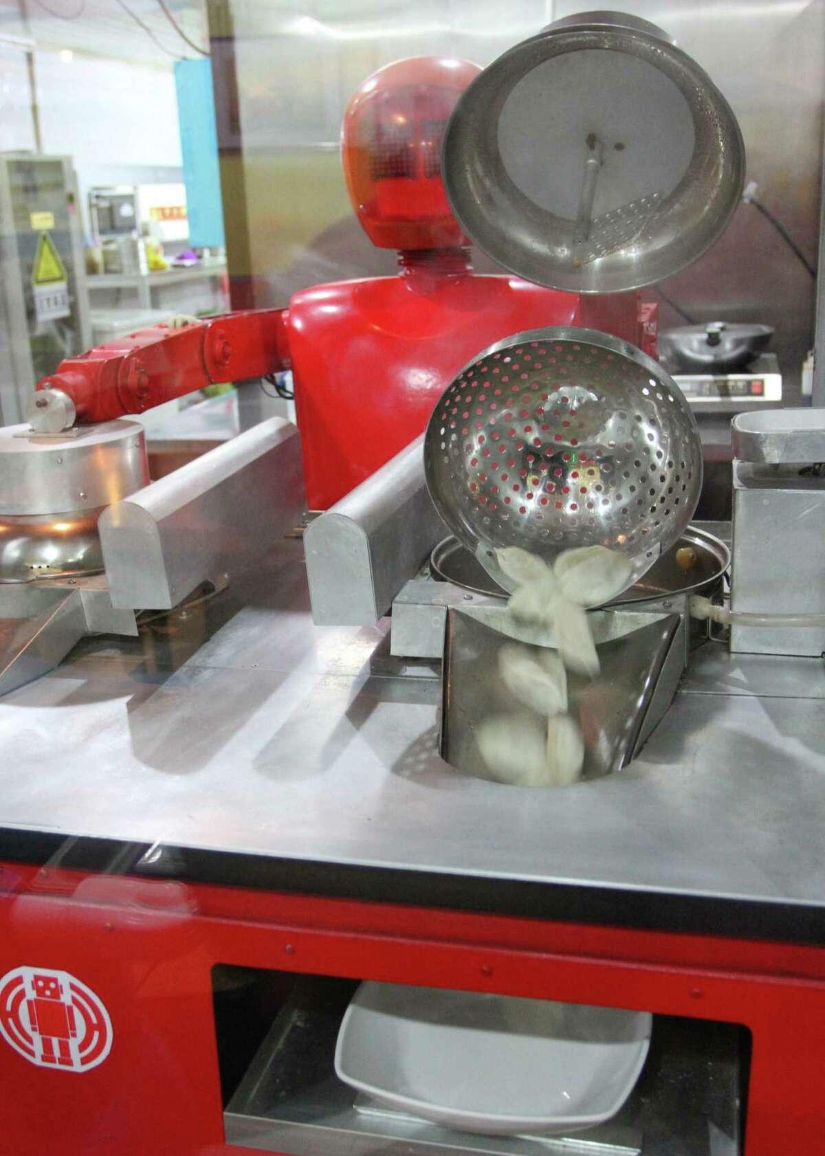 A robot cooks dumplings in the robot restaurant on Jan. 16, 2013.