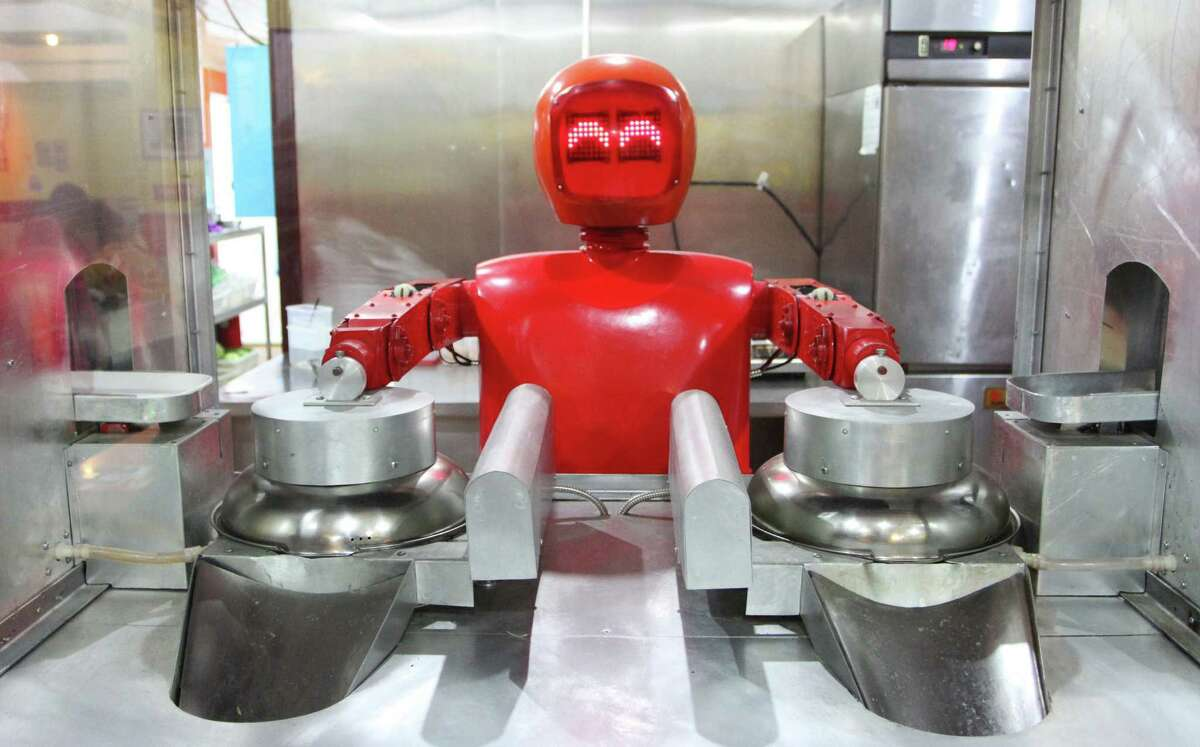 At Robot Restaurant 20, which opened last June, an usher robot greets diners by extending an arm and saying