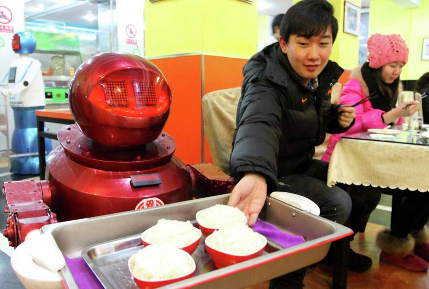 The robots reportedly can display more than 10 facial expressions and say basic welcoming lines to d