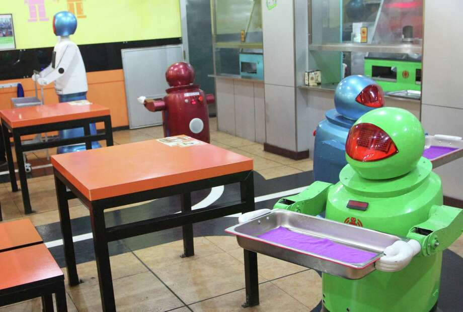 The robots can work for five hours on a two-hour charge, and are managed from a computer room. Photo: AFP, AFP/Getty Images / 2013 AFP