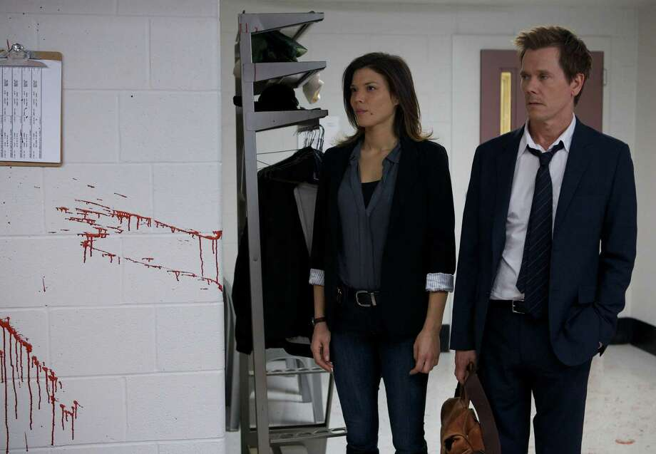 THE FOLLOWING: Former FBI agent Ryan Hardy (Kevin Bacon, R) is brought in to help solve a crime in the new drama THE FOLLOWING premiering Jan. 21 (9:00-10:00 PM ET/PT) on FOX. Also Pictured: Jeannane Goossen. ©2013 Fox Broadcasting Co. CR: FOX / 1