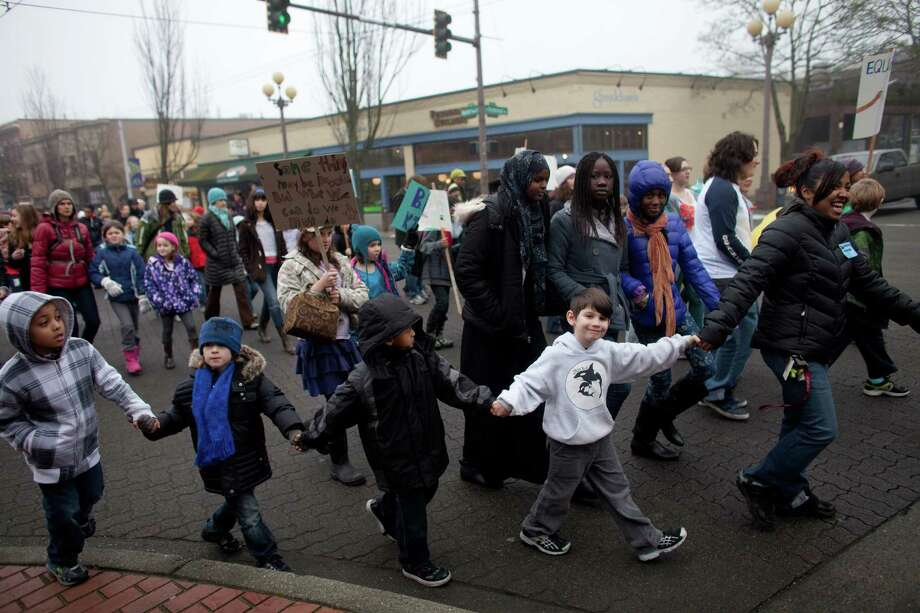 Students from Orca K-8 School march through Columbia City to honor Martin Luther King, Jr. on Friday, January 18, 2013. The students marched to Columbia Plaza where they participated in a food drive and fund raiser. The federal holiday recognizes the birthday of the civil rights leader. The holiday was first recognized by Ronald Reagan in 1983 but wasn't observed in all 50 states until 2000. Photo: JOSHUA TRUJILLO, SEATTLEPI.COM / SEATTLEPI.COM