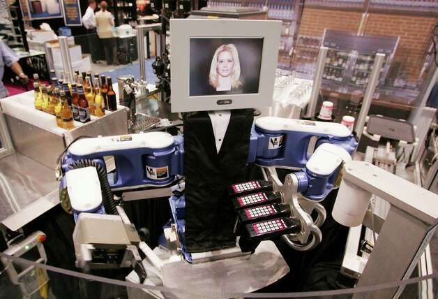 Motoman demonstrated its RoboBar robotic bartender at the National Restaurant Association's annual trade show on May 23, 2006 in Chicago. The high-speed, dual-arm robot, which costs about $150,000, can serve beer, wine and mix drinks. Photo: Scott Olson, Getty Images / 2006 Getty Images