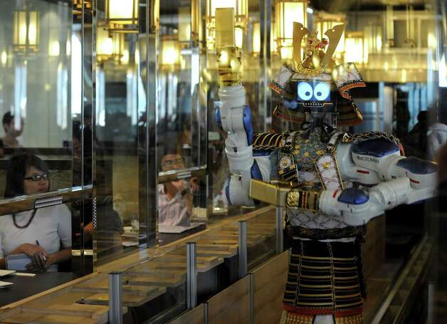 Turns out, robot restaurants have been around for a few years now. Here, a robot waiter performs a dance routine for customers at a Japanese robot restaurant in Bangkok, Thailand on April 1, 2010. Photo: PORNCHAI KITTIWONGSAKUL, AFP/Getty Images / 2011 AFP