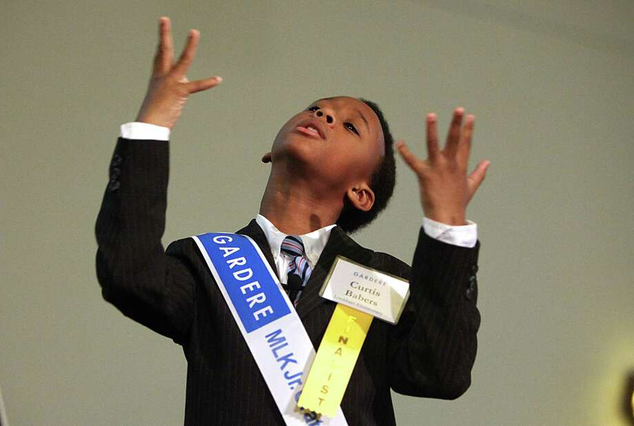 First place winner Curtis Babers, of Lockhart Elementary School, delivers his speech as he participates in the Martin Luther King Oratory Competition held at Antioch Missionary Baptist Church on Friday, Jan. 18, 2013, in Houston. Photo: Mayra Beltran, Houston Chronicle / © 2013 Houston Chronicle