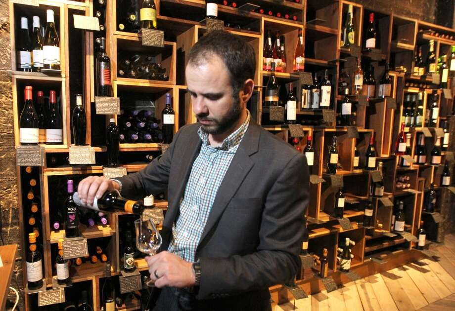 Wine Director Gerard Maristany pours a glass of sherry.