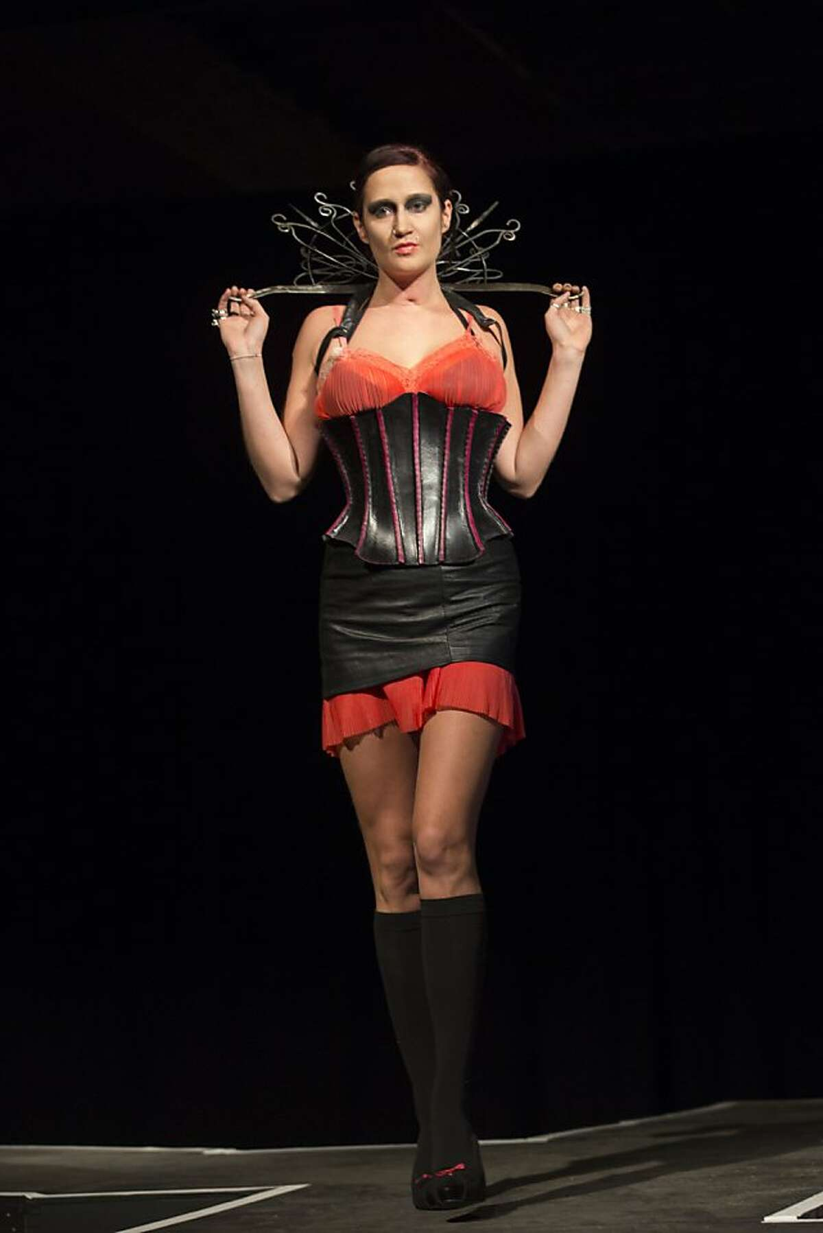 Model Heidi Robinson wears an outfit by designers Sam Waller (leather) and Celeste Flores (iron work) during Hot Couture fashion show media preview at The Crucible in Oakland, Calif. on Thursday, Jan. 10, 2013.
