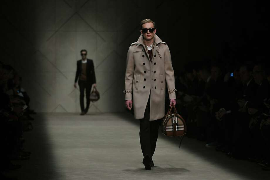 Burberry lets buyers customize trench coats. Photo: Tiziana Fabi, AFP/Getty Images