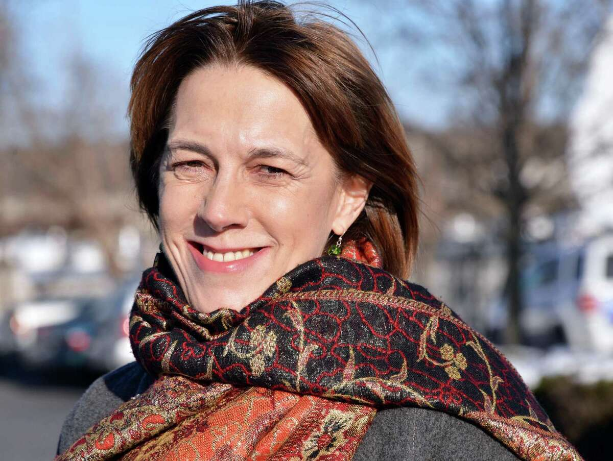 Cecelia Tkaczyk is all smiles as she arrives for a television interview in Albany after she was announced the winner in the state senate race against George Amedore Friday Jan. 18, 2013. (John Carl D'Annibale / Times Union)